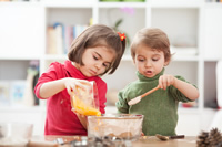 ©  bokan,  Two kids cooking at home