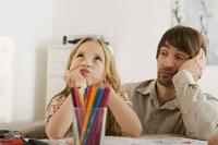 ©  firstflight,  Father and daughter (8-9) doing homework